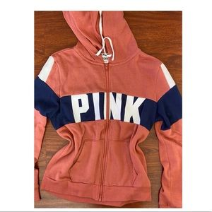 Pink zip up sweater. Worn once.